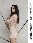alluring model in beige laced... | Shutterstock . vector #1340956070