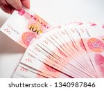 hand holding chinese yuan... | Shutterstock . vector #1340987846