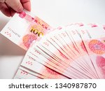 hand holding chinese yuan... | Shutterstock . vector #1340987870