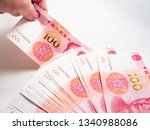 hand holding chinese yuan... | Shutterstock . vector #1340988086