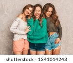 three young beautiful smiling... | Shutterstock . vector #1341014243