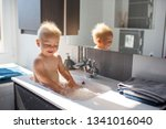 baby taking bath in sink. child ... | Shutterstock . vector #1341016040