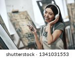 young beautiful woman painting... | Shutterstock . vector #1341031553