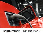 electric car getting recharged... | Shutterstock . vector #1341051923