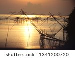 Small photo of Morning light patch at the mouth of the fish that are unflattering livelihood of Phatthalung.