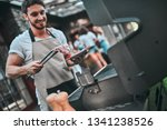 handsome man is making grill... | Shutterstock . vector #1341238526