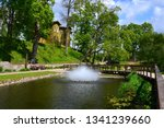 park with small white fountain  ... | Shutterstock . vector #1341239660