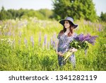 pregnant girl in a field with... | Shutterstock . vector #1341282119