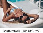 beautiful woman in black...   Shutterstock . vector #1341340799