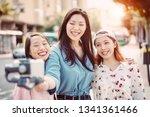 happy asian friends making... | Shutterstock . vector #1341361466