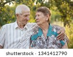 married couple. smiling... | Shutterstock . vector #1341412790