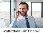 handsome businessman talking on ... | Shutterstock . vector #1341444260