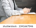 male employee is waiting for a... | Shutterstock . vector #1341667046