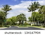 Road to community buildings in Naples, Florida - stock photo