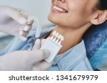 close up of stomatologist hands ...   Shutterstock . vector #1341679979