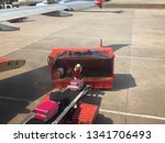 baggage handlers working at don ... | Shutterstock . vector #1341706493