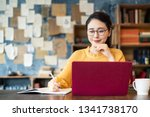 young asian woman working in... | Shutterstock . vector #1341738170