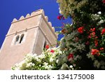 Tower and flowers in Sousse - stock photo