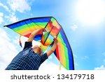 Little Boy Flies A Kite Into...