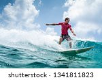 Surfer Rides The Wave At Sunny...