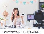 beautiful asian woman blogger... | Shutterstock . vector #1341878663