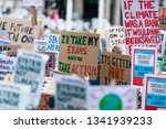 people with banners protest as... | Shutterstock . vector #1341939233