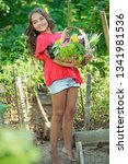 child with vegetables  | Shutterstock . vector #1341981536