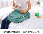 Woman Packing Baby Accessories...