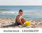 little boy play with sand on... | Shutterstock . vector #1342086359