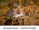 Small Kid Reading A Book In Th...