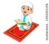 muslim boy reading holy quran | Shutterstock .eps vector #1342201196