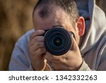 a man takes pictures with a... | Shutterstock . vector #1342332263