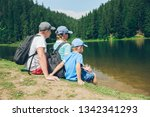 family sitting at beach of... | Shutterstock . vector #1342341293