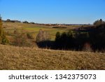 looking down from a hill at a...   Shutterstock . vector #1342375073