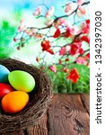 colored easter eggs in the nest ...   Shutterstock . vector #1342397030