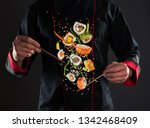 closeup of master chef holding... | Shutterstock . vector #1342468409