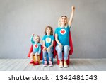 family of superheroes playing... | Shutterstock . vector #1342481543