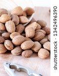 almonds on wood bag nutcracker   Shutterstock . vector #1342496390