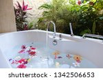 Bathroom With Flowers In The...