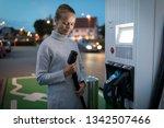 young woman charging an... | Shutterstock . vector #1342507466