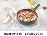 bowl of clam chowder garnished... | Shutterstock . vector #1342529360
