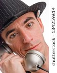 Headshot of a Caucasian Male Wearing a Fedora Style Hat and Talking on the Phone - Extreme Closeup - stock photo