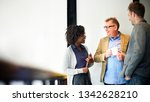 coworkers talking during a... | Shutterstock . vector #1342628210