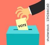 hand putting vote into ballot...