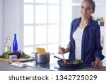 young woman in the kitchen...   Shutterstock . vector #1342725029