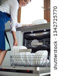 dishwasher. young woman in the...   Shutterstock . vector #1342725770
