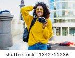 happy confident  african woman...   Shutterstock . vector #1342755236