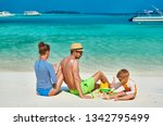 family on beach  young couple... | Shutterstock . vector #1342795499