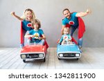 family of superheroes playing... | Shutterstock . vector #1342811900