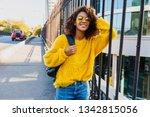 carefree african woman walking...   Shutterstock . vector #1342815056